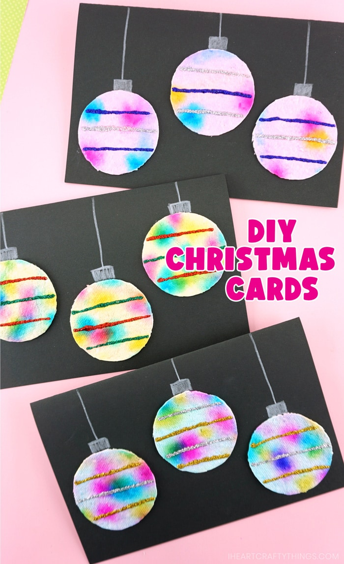 """Vertical close up image of three hanging ornaments Christmas cards with the words """"DIY Christmas Cards"""" in the right center of the card."""