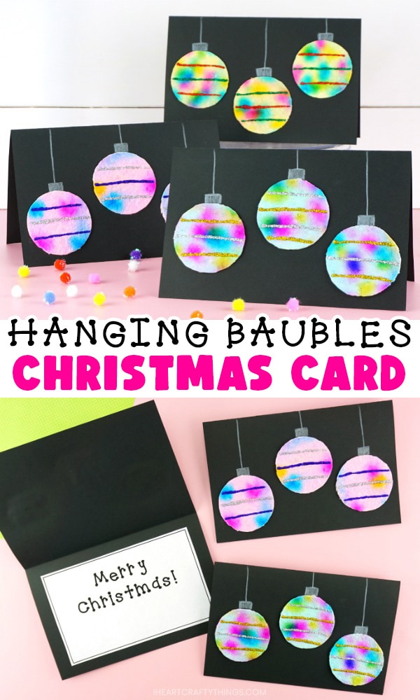 """Vertical two image collage showing Christmas cards propped up in top image and cards laying down flat with one open in the bottom image. Between images is the text """"Hanging Baubles Christmas Card""""."""
