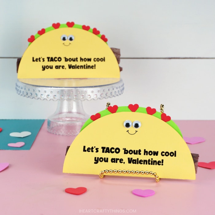 Image showing to taco Valentine's Day cards propped up with one in focus in the front and one out of focus in the back.