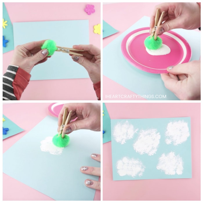 Four image collage showing how to attach the pom-pom to the clothespin and how to dip it into white paint and onto the blue cardstock paper to paint clouds.